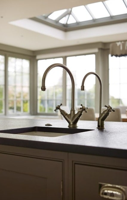 Stylish kitchen sink with roof lantern in the background