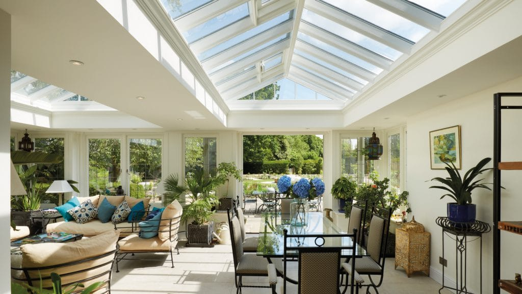 Fresh and bright sun-room with twin roof lanterns