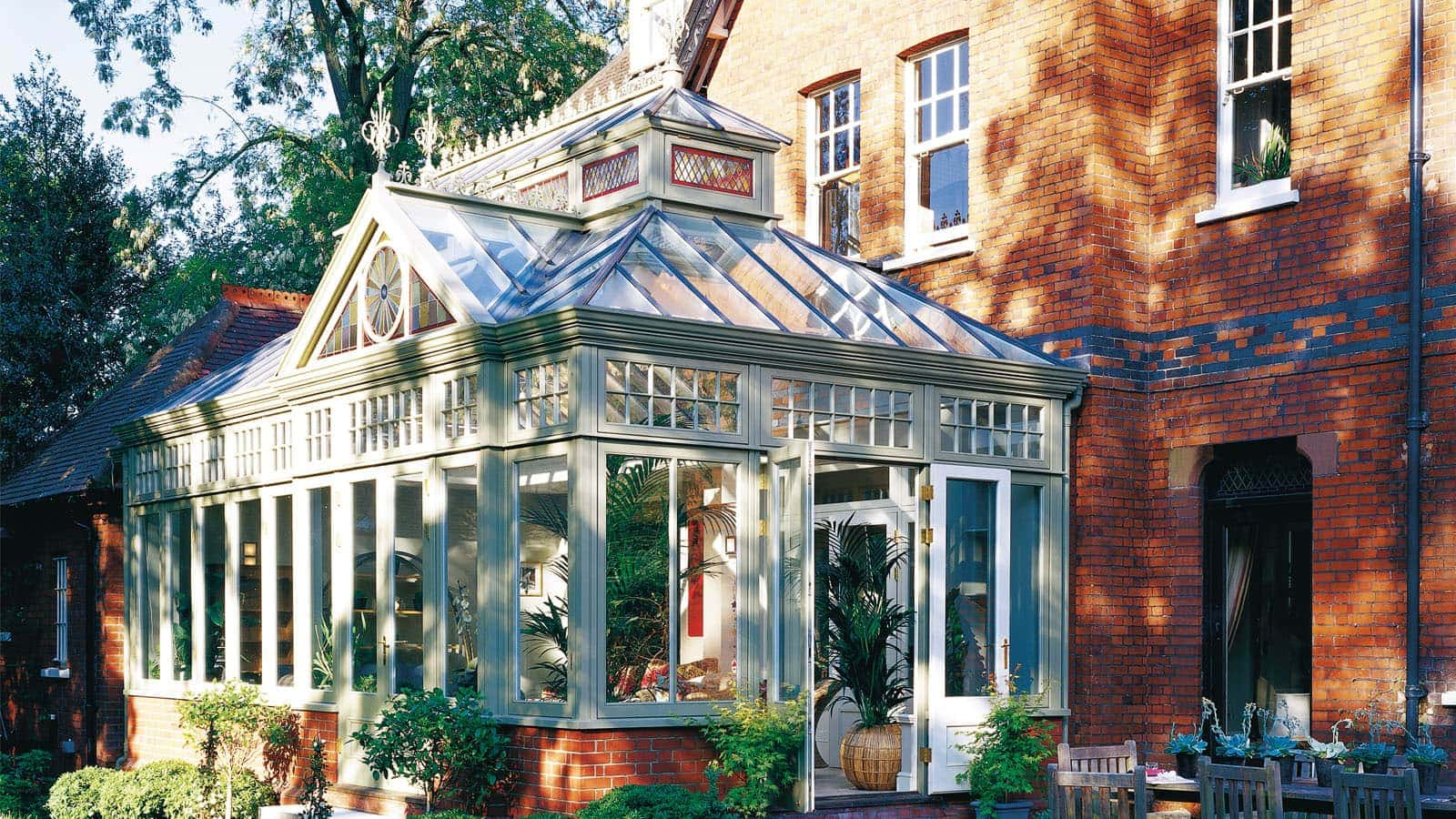 Traditional timber conservatory with coloured glazed gable