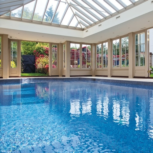 Timber and glass pool house with large roof lantern