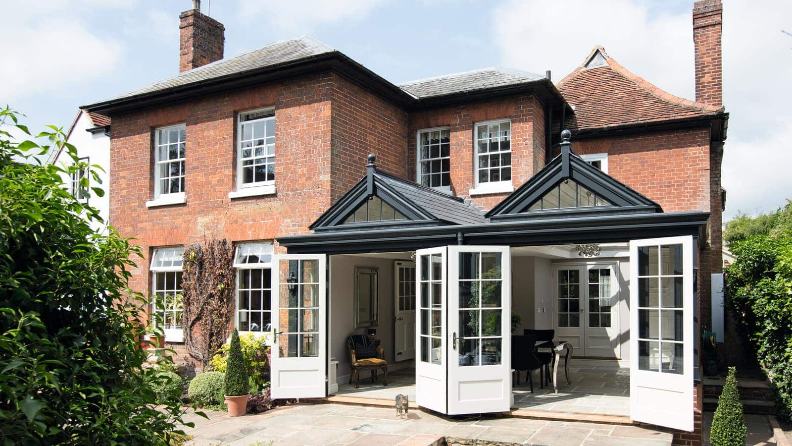 Period vicarage traditionally designed garden room featuring two vertically glazed gable ends