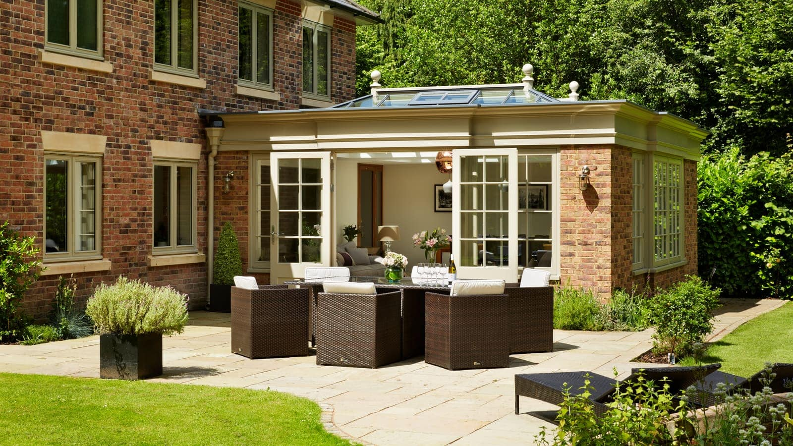 Simple and striking twin lantern orangery