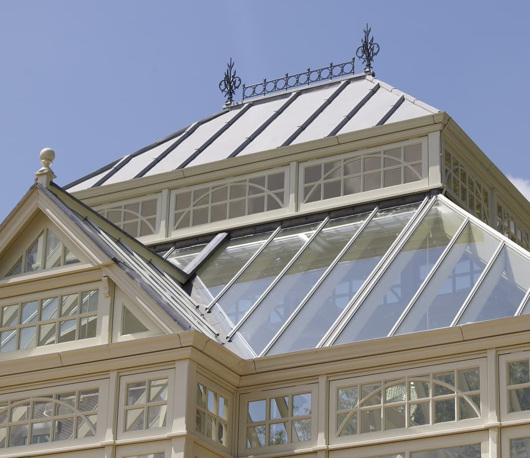 Elaborate conservatory with large decorative roof crestings and finials