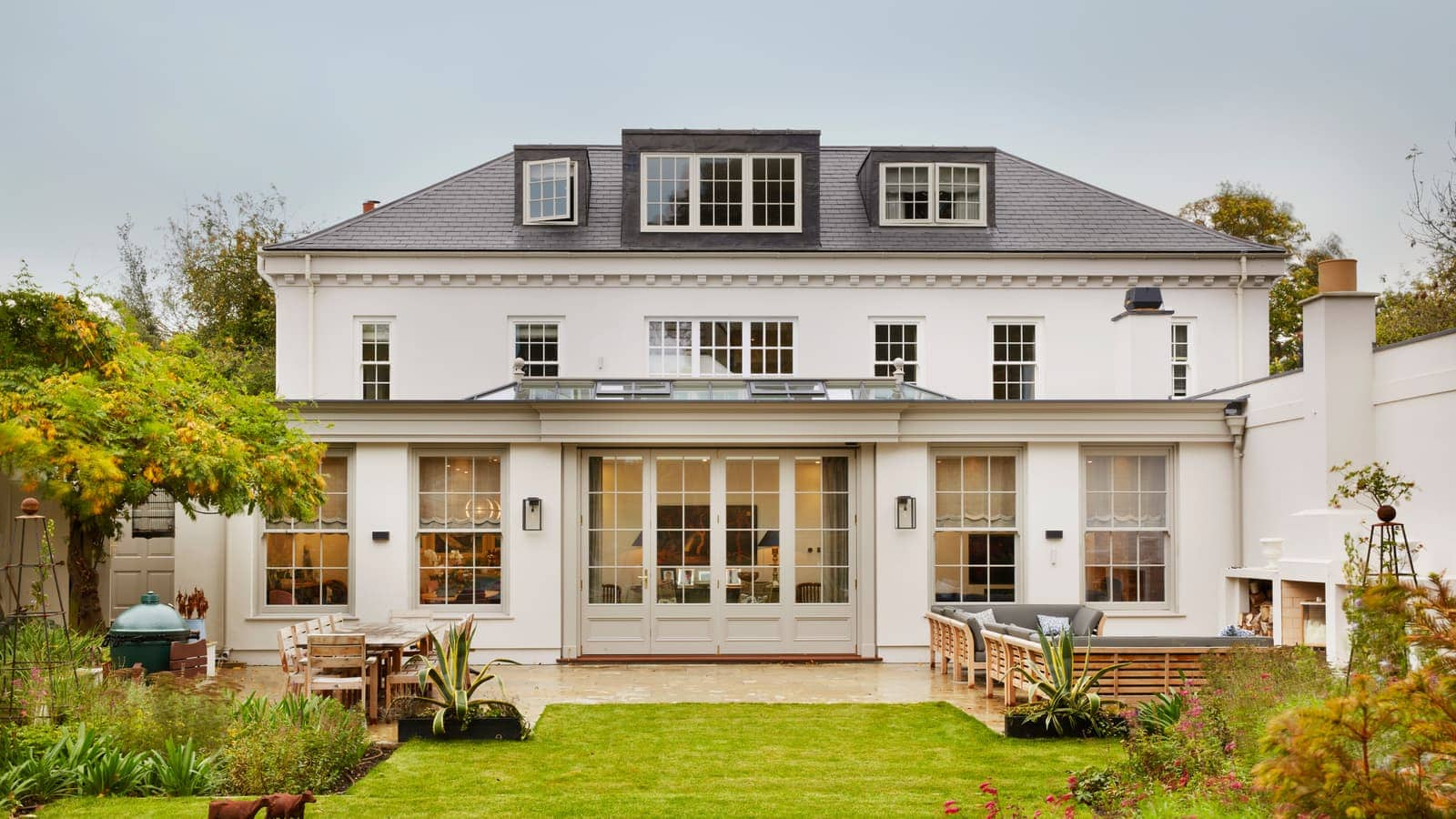 Beautiful Georgian house with large orangery extension with French doors opening onto the garden