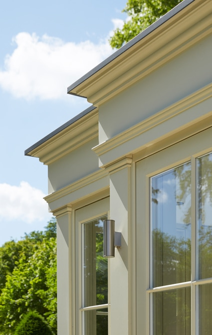 Classic proportions with deep entablature and delicate joinery