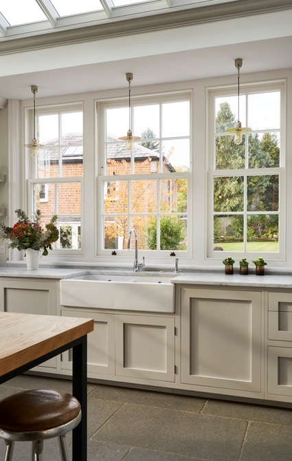 Beautiful sliding sash windows with large kitchen butler sink