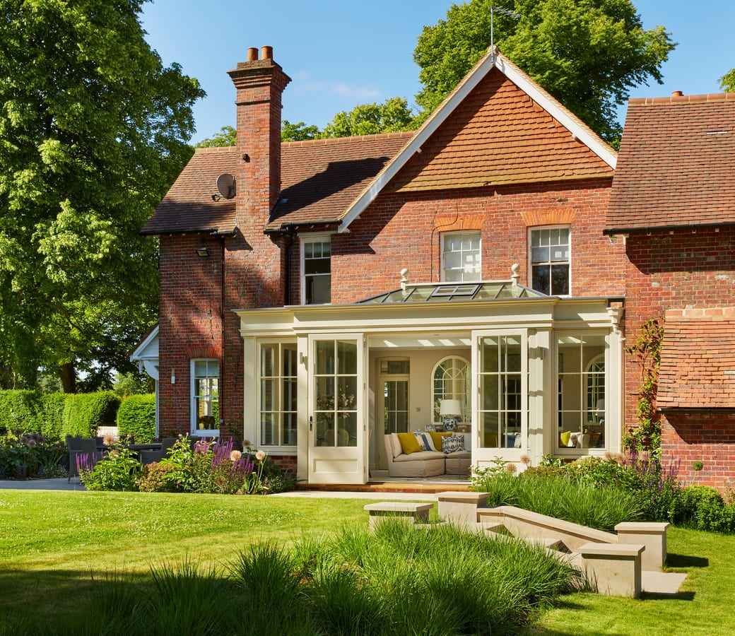 Exterior of Westbury Orangery in a beautifully landscaped English country garden