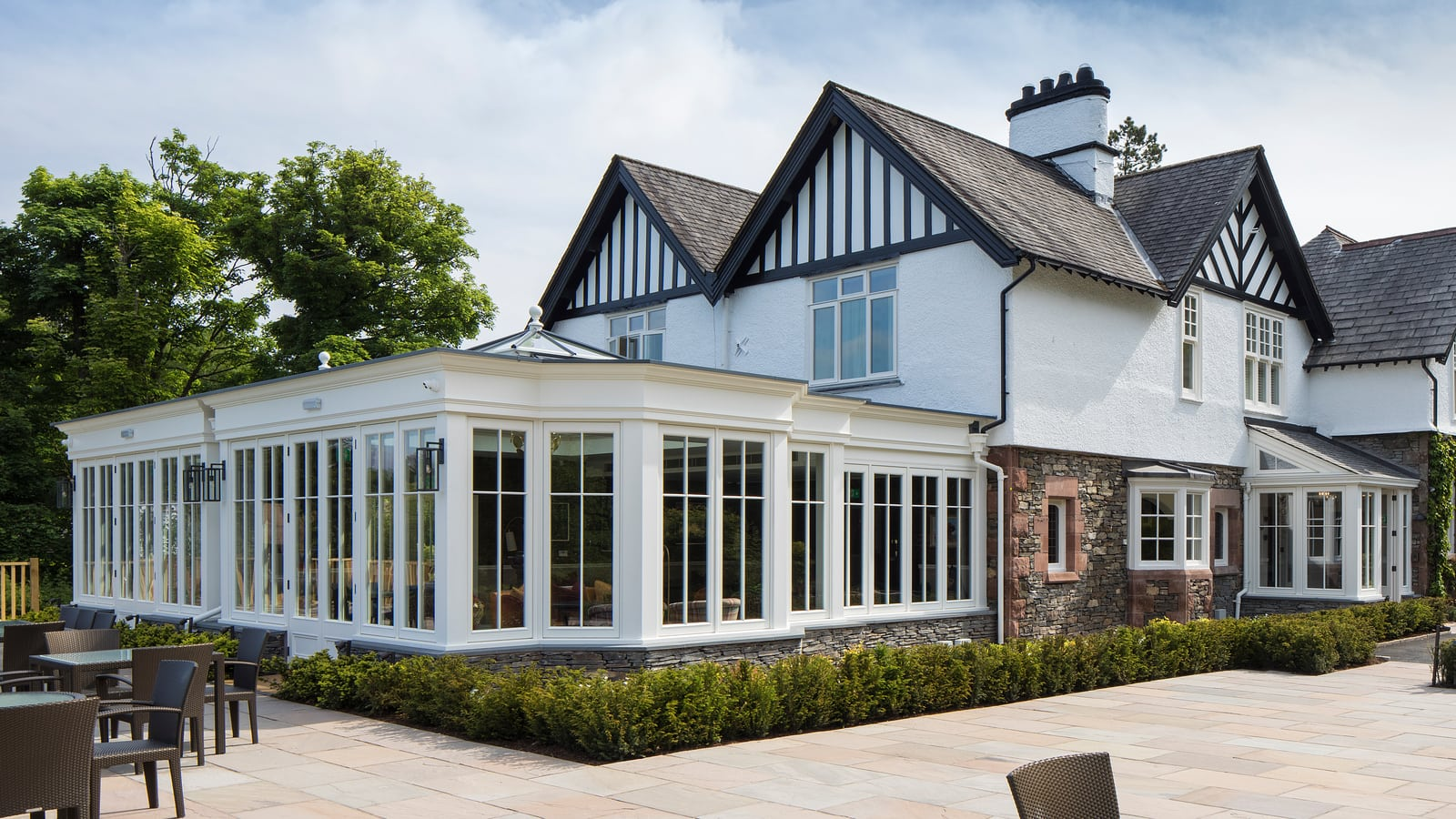 Westbury renovation - Large orangery with generous height, with painted frames built in Accoya