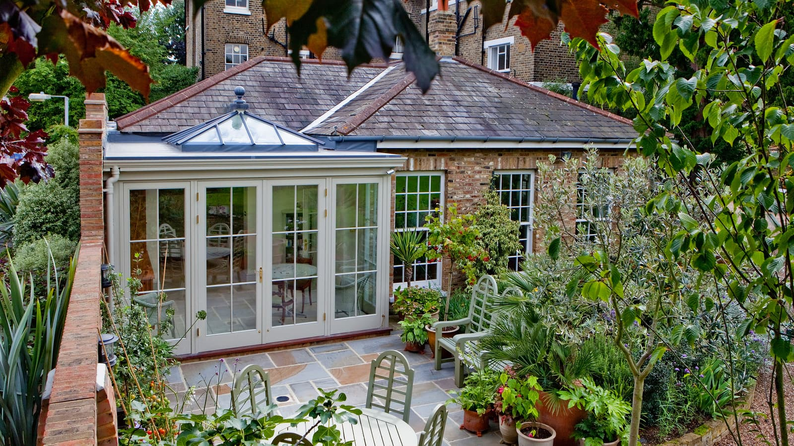 An elegant orangery garden room looking out onto a city courtyard garden