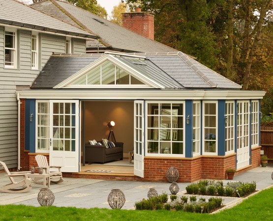 Timber Garden Room Extension painted in Blue and White