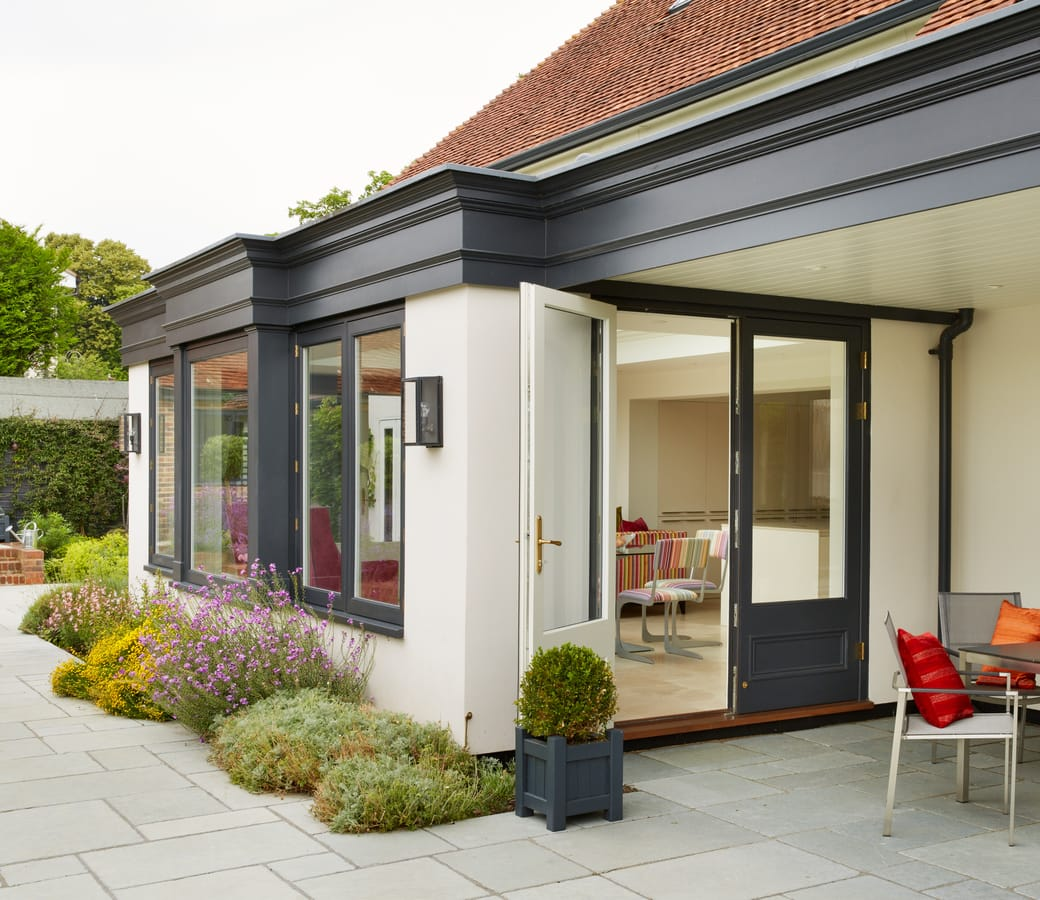 Contemporary Orangery extension with French doors painted in Westbury Black
