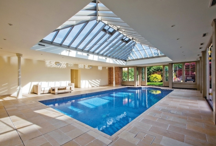 Natural stone flooring is the perfect choice for pool houses