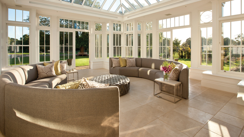 Agean Limestone Tumbled stone flooring reflects the natural light pouring into this garden room extension