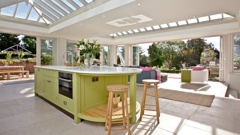 Our Burford Limestone Tumbled stone flooring complements the lime green painted finish of this customer's kitchen island