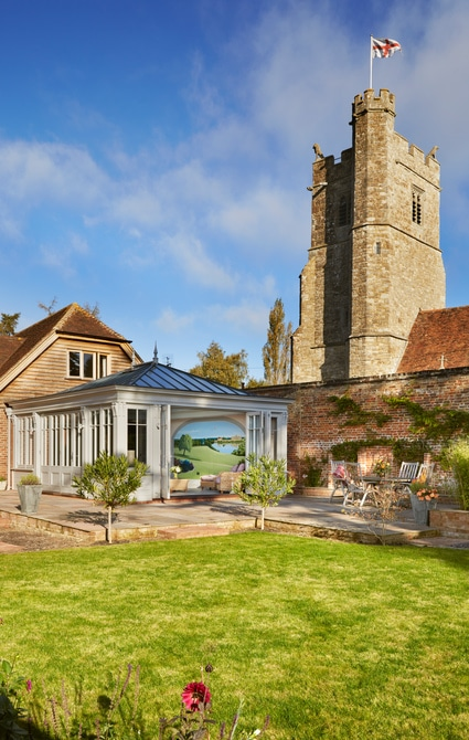 Orangery with village church backdrop