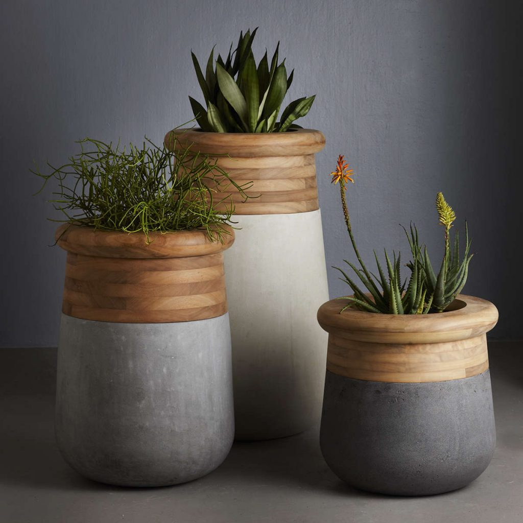 poolside furniture - three wooden plant pots with stone effect