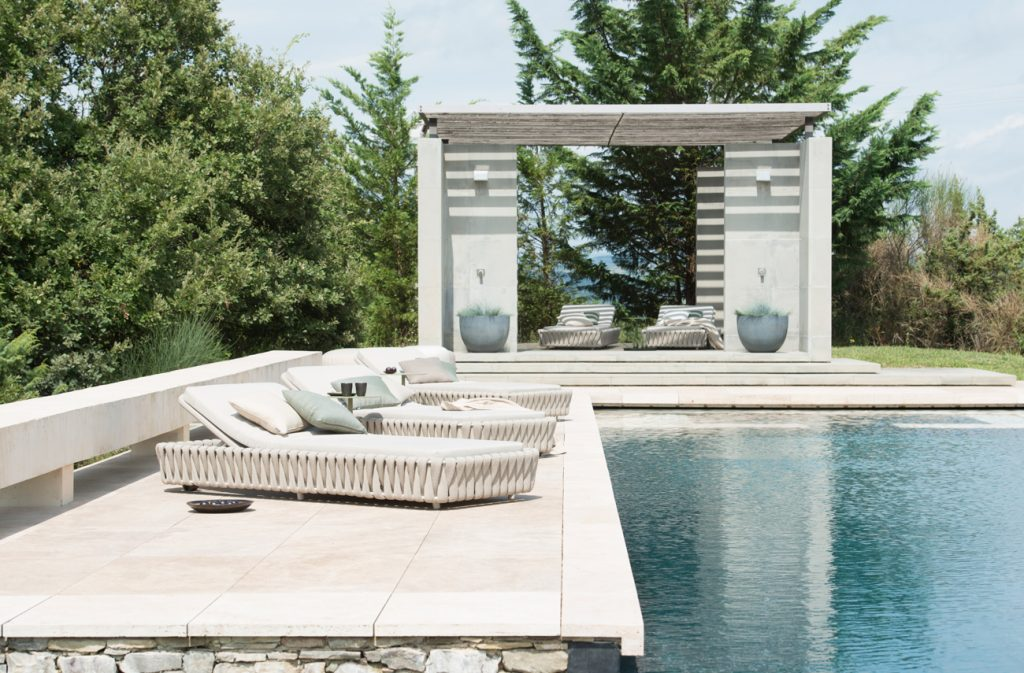 poolside furniture - woven sun loungers with scatter cushions